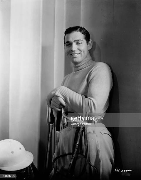 American actor Clark Gable dressed for a game of polo