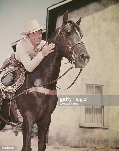 American actor Clark Gable on horseback circa 1955