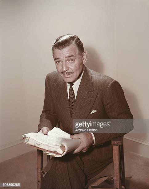 American actor Clark Gable reading a script circa 1955
