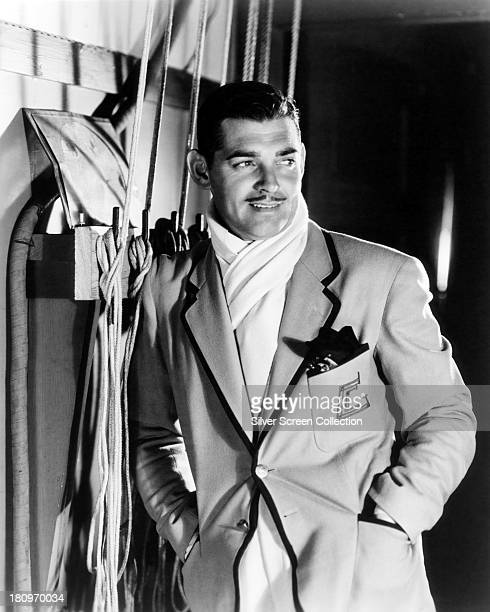 American actor Clark Gable wearing a monogrammed blazer and white scarf circa 1935
