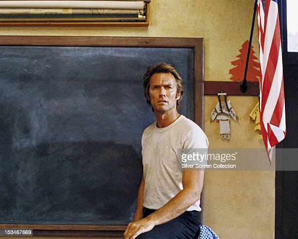 American actor Clint Eastwood as bank robber Thunderbolt in front of a classroom blackboard in 'Thunderbolt and Lightfoot' directed by Michael Cimino...