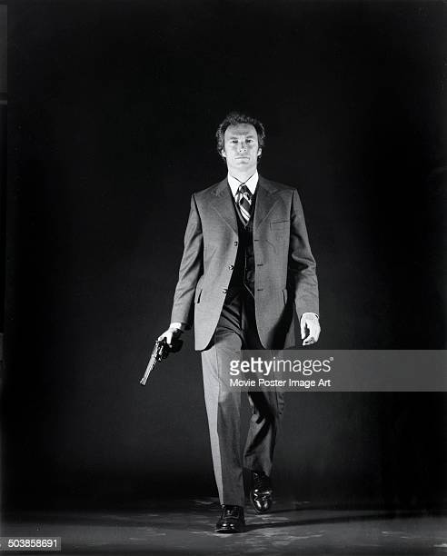 American actor Clint Eastwood as 'Dirty' Harry Callaghan in a publicity still for the movie 'The Enforcer' 1976 He is holding his iconic 44 Magnum