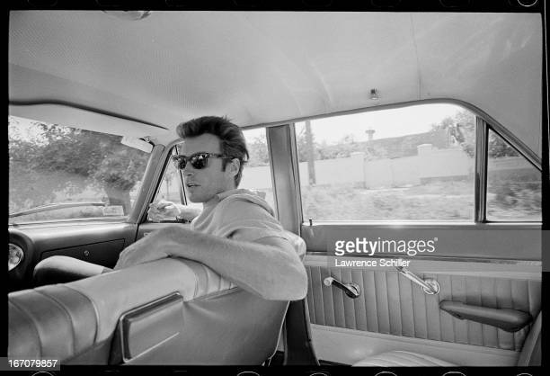 American actor Clint Eastwood sits in the front seat of a car as he travels to the set during the filming of 'Two Mules for Sister Sara' Durango...