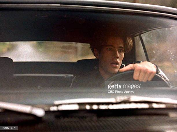 American actor Dana Ashbrook drives a car in a scene from the pilot episode of the television series 'Twin Peaks' originally broadcast on April 8 1990