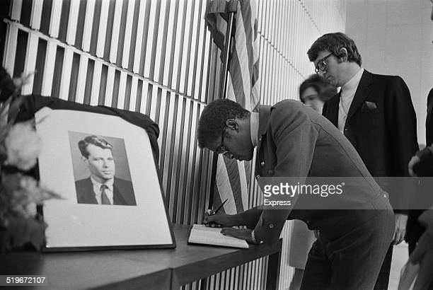 American actor dancer and singer Sammy Davis Jr signing the book of condolences for Robert Kennedy at the American Embassy London 6th June 1968
