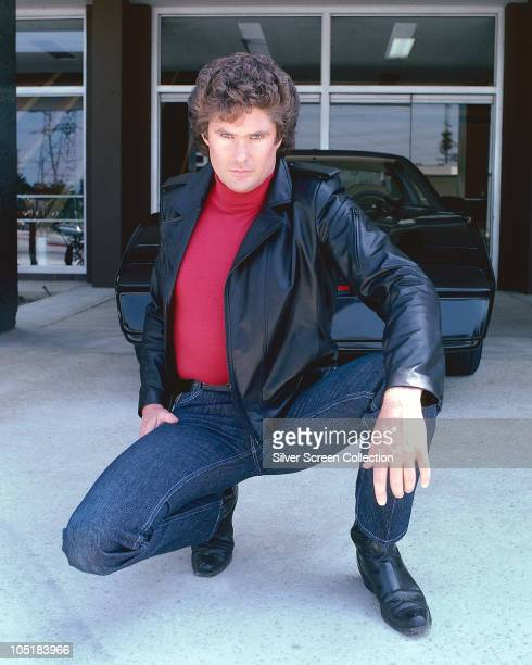 American actor David Hasselhoff star of the hit tv show 'Knight Rider' circa 1983 Behind him is the artificially intelligent supercar KITT