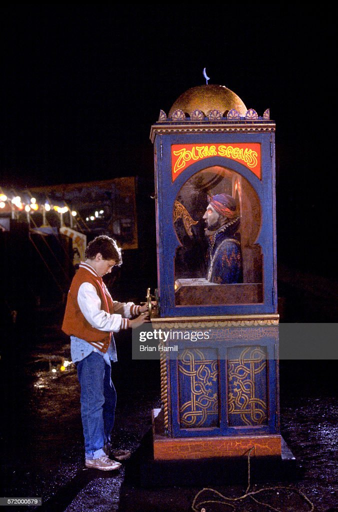 American actor David Moscow makes a wish at an arcade fortune teller machine in a scene from the film 'Big' 1988