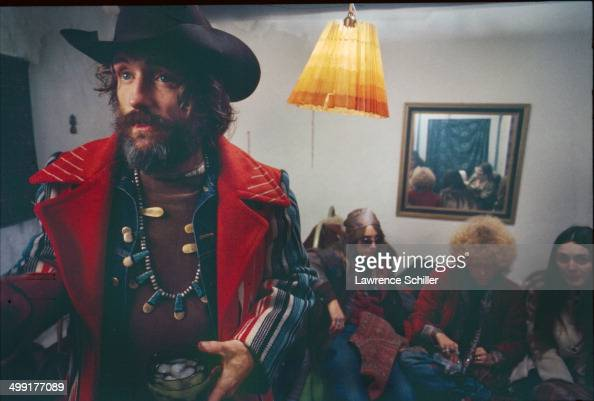 American actor Dennis Hopper with groupies and various hangerson in his home a wouldbe commune named the Mabel Dodge Luhan House during the filming...