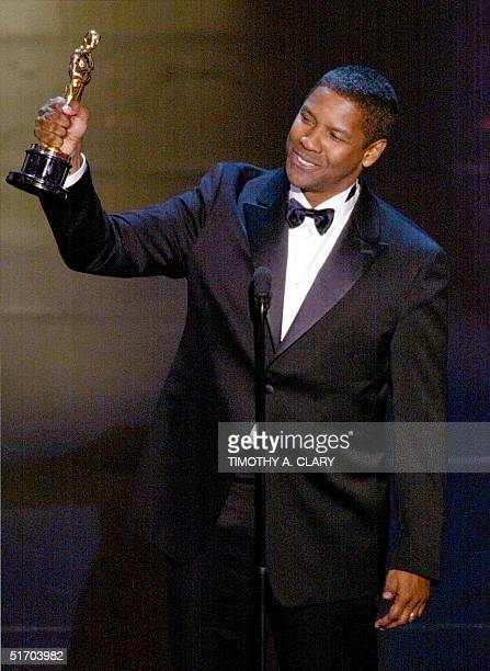 Denzel Washington accepts his Oscar for Best performance by an actor in a leading role during the 74th Academy Awards at the Kodak Theater in...