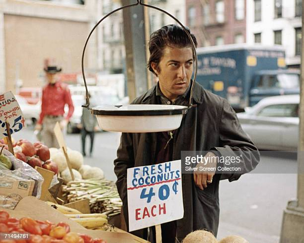 American actor Dustin Hoffman as 'Ratso' Rizzo in a scene from director John Schlesinger's film 'Midnight Cowboy' 1969 In the background is Jon...