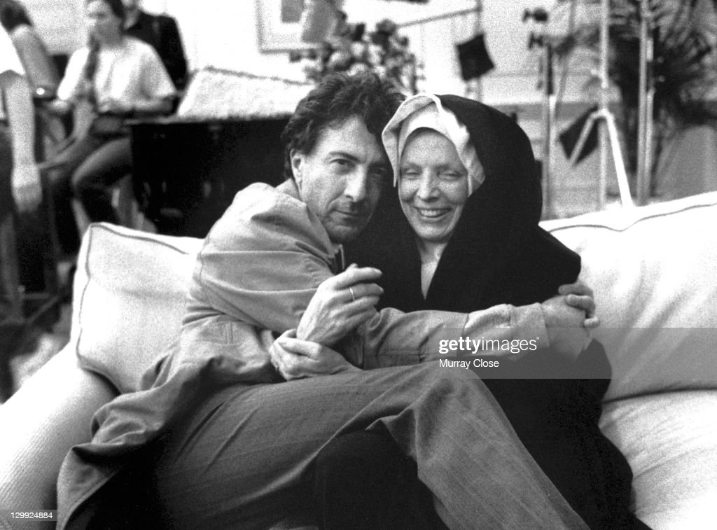 American actor Dustin Hoffman embraces a co-star in a nun costume on the set of the film 'Accidental Hero', 1992.