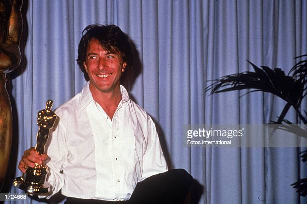 American actor Dustin Hoffman holds up the Oscar statuette he won for Best Actor for his role in the film 'Kramer vs Kramer' Academy Awards Dorothy...