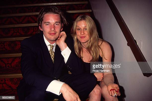 American actor Ethan Hawke and a an unidentified woman sit on a staircase at the Obie Awards New York May 22 1995