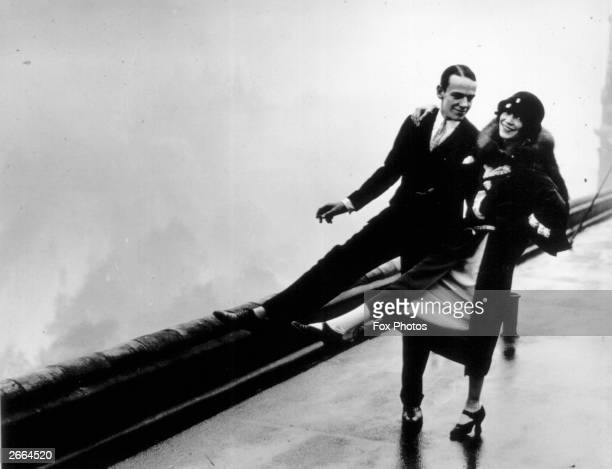 American actor Fred Astaire dancing on the roof of the Savoy Hotel in London with his sister and dancing partner Adele
