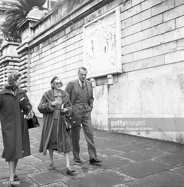'American actor Gary Cooper walking on via Veneto in Rome with his wife Veronica Balfe and their daughter Maria Cooper Rome 1959 '
