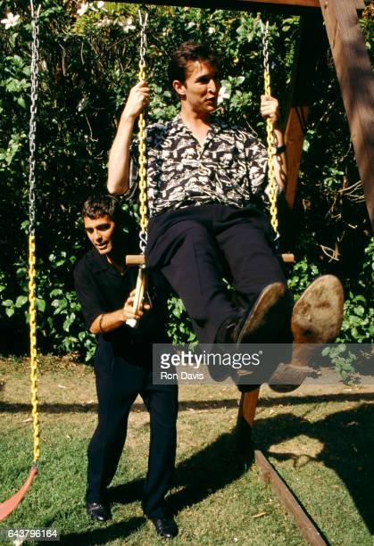 American actor George Clooney pushes friend American film and television actor Noah Wyle on a swingset circa 1998 in Los Angeles California