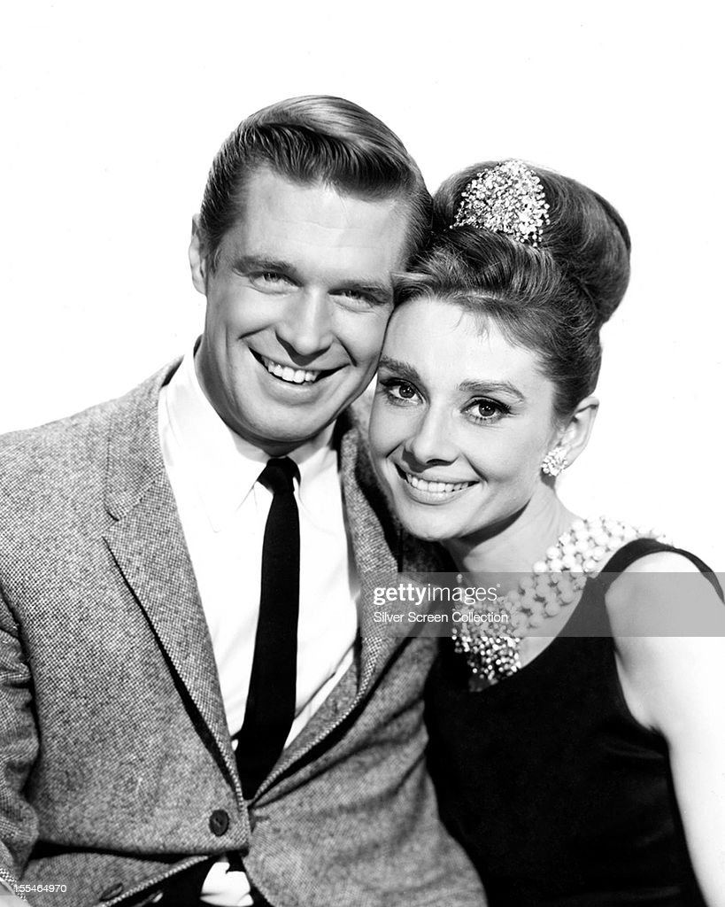 American actor George Peppard as Paul Varjak and Belgianborn actress Audrey Hepburn as Holly Golightly in 'Breakfast at Tiffany's' directed by Blake...