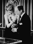 American actor Goldie Hawn presents the Best Actor Oscar to Frank McCarthy accepting on behalf of George C Scott for his role in the film 'Patton' on...