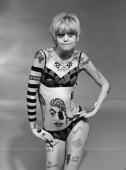 American actor Goldie Hawn wears body paint and a bikini in a promotional portrait for the television series 'LaughIn'