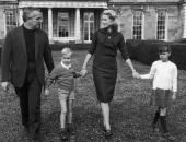 American actor Grace Kelly on a driveway in front of a ranchstyle house near Palm Springs Florida with her husband Prince Rainier III of Monaco and...