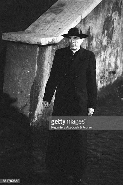 American actor Gregory Peck acting dressed as a priest for the TV series The Scarlet and the Black Rome 8th July 1982