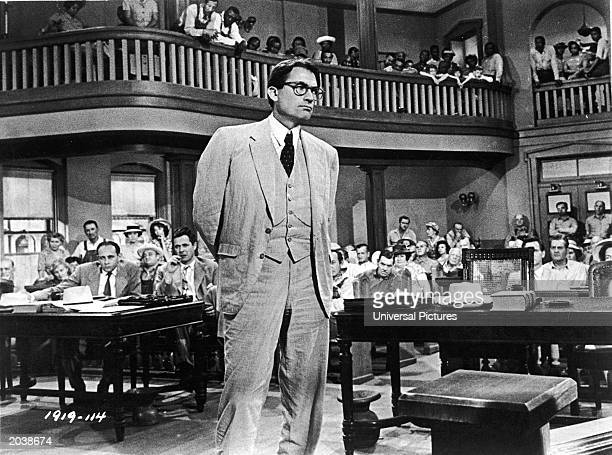 American actor Gregory Peck as Atticus Finch stands in a courtroom in a scene from director Robert Mulligan's film 'To Kill A Mockingbird' 1962 Actor...