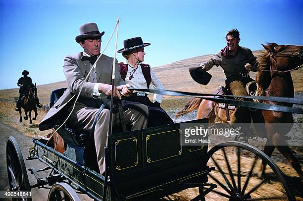 American actor Gregory Peck as James McKay Carroll Baker as Patricia Terrill and Chuck Connors as Buck Hannassey in a scene from the western 'The Big...