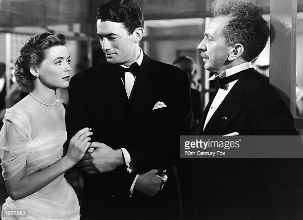 American actor Gregory Peck introduces American actress Dorothy McGuire to Sam Jaffe in a still from the film 'Gentleman's Agreement' directed by...