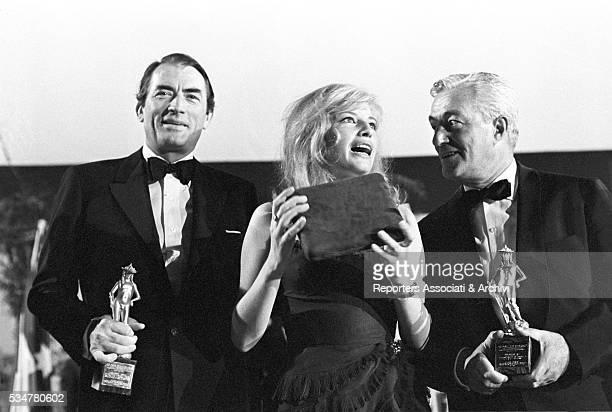American actor Gregory Peck Italian director Vittorio de Sica and Italian actress Monica Vitti receiving the David di Donatello Award Taormina 28th...