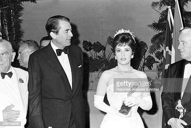American actor Gregory Peck Italian director Vittorio de Sica and Italian actress Gina Lollobrigida receiving the David di Donatello Award Taormina...