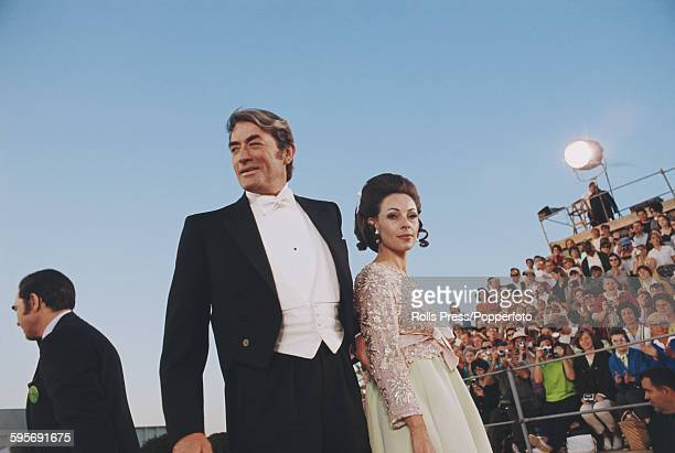 American actor Gregory Peck pictured with his wife Veronique Peck as they attend the 40th Academy Awards at the Santa Monica Civic Auditorium in...
