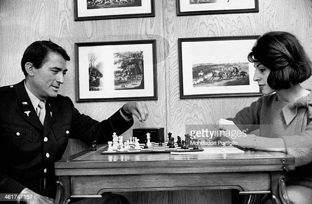 American actor Gregory Peck playing chess with his wife Veronique Passani inside their caravan while shooting the film Captain Newman MD Hollywood...