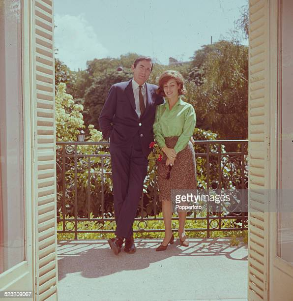 American actor Gregory Peck posed with his wife Veronique Passini on a balcony in Paris in 1963