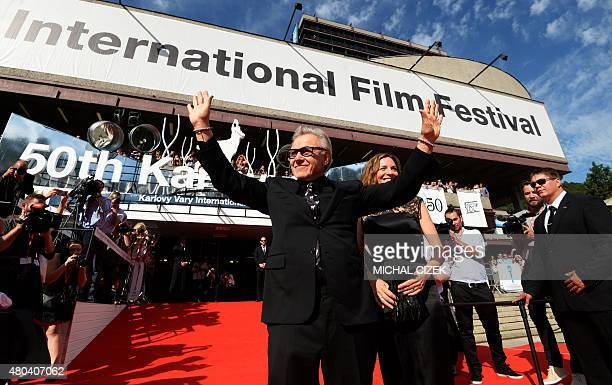 American actor Harvey Keitel and his wife Daphne Kastner greet their fans at the red carpet during the closing ceremony of the 50th Karlovy Vary...