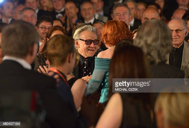 American actor Hervey Keitel greets Czech actress Iva Janzurova during the closing ceremonies of the 50th Karlovy Vary International Film Festival in...