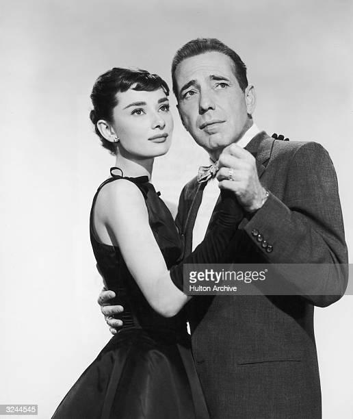 American actor Humphrey Bogart and Belgianborn actor Audrey Hepburn 1929 1993 dance together in a promotional portrait from director Billy Wilder's...