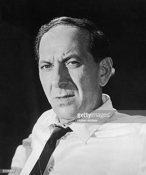 American actor Jack Klugman wears a shirt and tie in a promotional headshot portrait for director Gordon Douglas' film 'The Detective'