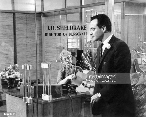 American actor Jack Lemmon as CC Baxter and Edie Adams as Miss Olsen in 'The Apartment' directed by Billy Wilder 1960