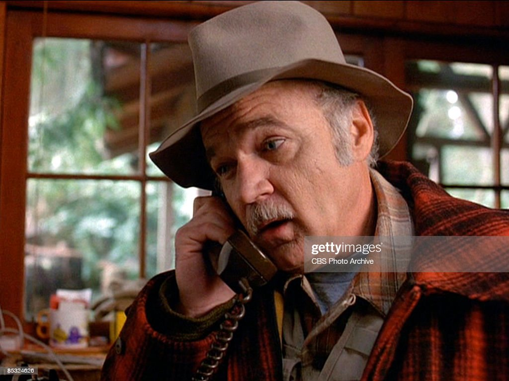 American actor Jack Nance (1943 - 1996) (as Pete Martell) talks on a telephone in a scene from the pilot episode of the television series 'Twin Peaks,' originally broadcast on April 8, 1990.