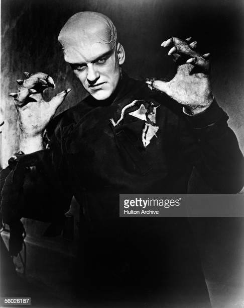 American actor James Arness holds up his clawlike hands in a publicity still from the horror film 'The Thing ' 1951 In the movie Arness plays a pilot...