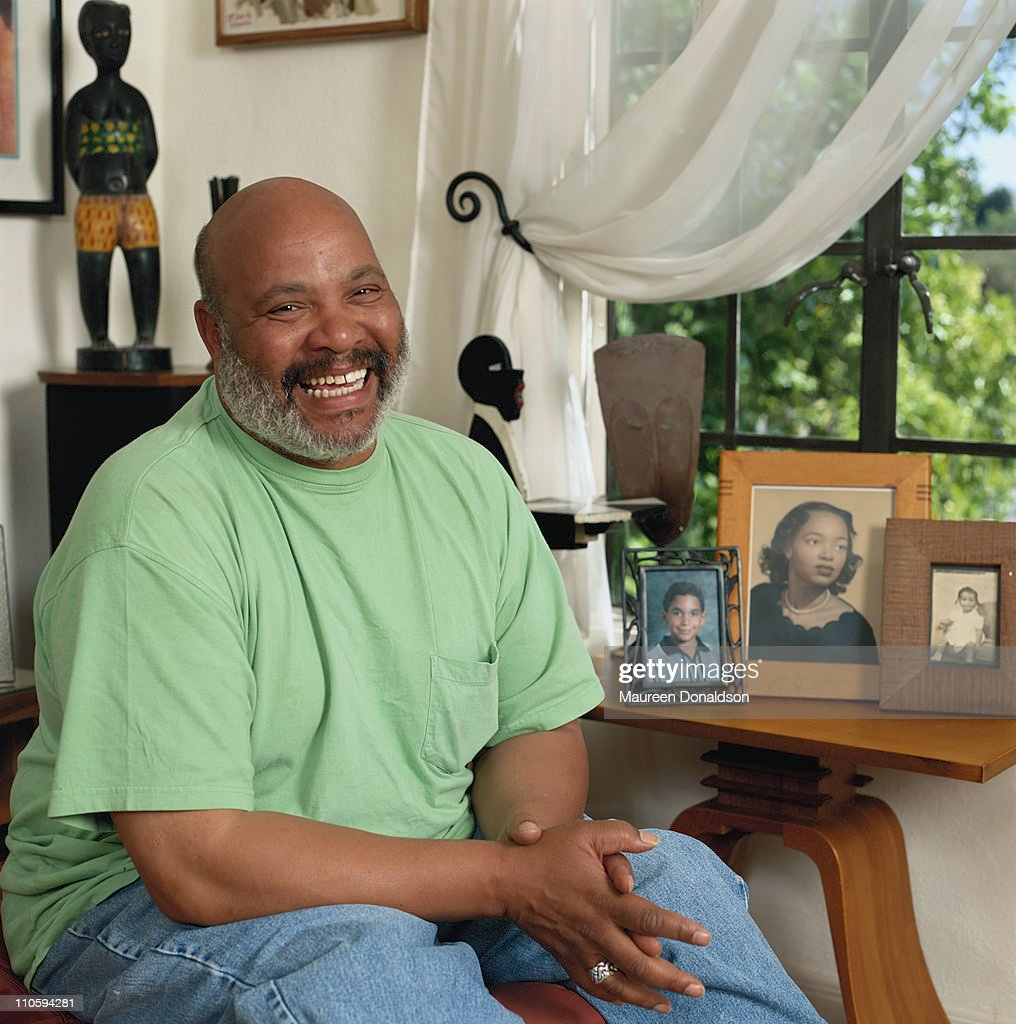 American actor James Avery with some family photographs, circa 1995. His best-known role is that of Uncle Phil in 'The Fresh Prince of Bel-Air'.