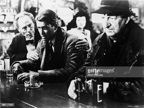 American actor James Stewart sits glumly at a bar in a scene from the film 'It's a Wonderful Life' directed by Frank Capra California 1946
