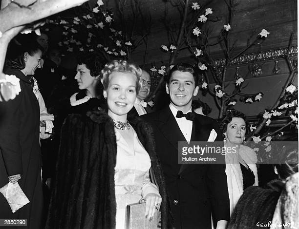 American actor Jane Wyman and her husband actor and politician Ronald Reagan attend an unidentified event 1939 Wyman carries a purse and wears a fur...