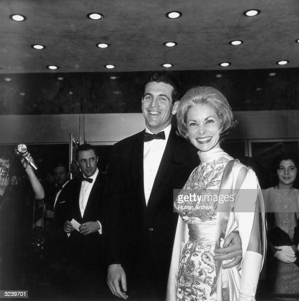 American actor Janet Leigh smiles with her husband Robert Brandt as they attend the premiere of director David Lean's film 'Lawrence of Arabia' Leigh...