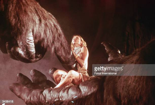 American actor Jessica Lange sits in the hand of a giant gorilla in a still from the film 'King Kong' directed by John Guillermin