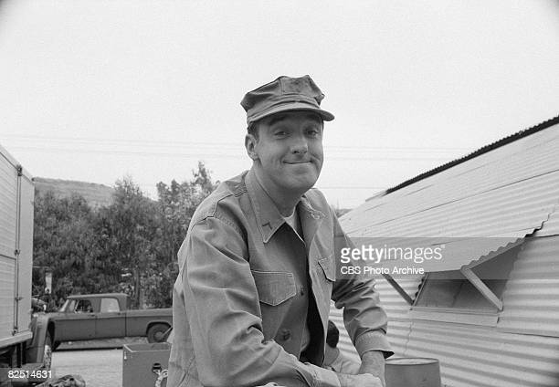American actor Jim Nabors smiles outside a Quonset hut during the filming of an episode of the television comedy series 'Gomer Pyle USMC' entitled...