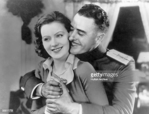 American actor John Gilbert embracing Swedish leading actress Greta Garbo in a scene from the MGM film 'Love'