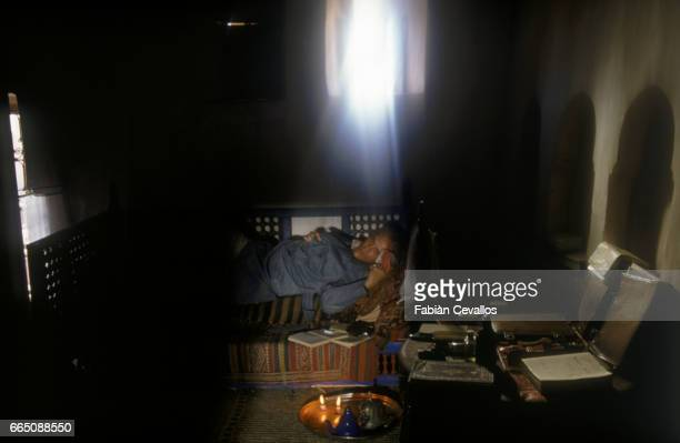 American actor John Malkovitch rests on a sofa during the shooting of the movie Un The au Sahara or Il Te Nel Deserto originally The Sheltering Sky...