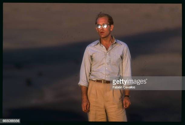 American actor John Malkovitch stands in the desert at twilight during the shooting of the movie Un The au Sahara or Il Te Nel Deserto originally The...