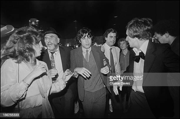 American actor John Travolta arrives surrounded by security men at the London premiere of 'Grease' at the Odeon Leicester Square London 1978